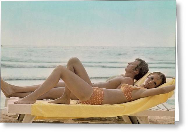 Cheryl Tiegs Modeling A Bikini At A Beach Greeting Card by William Connors