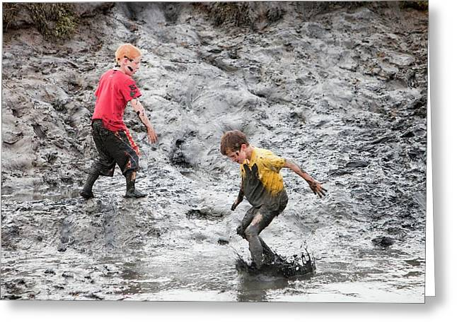 Children Playing In A Muddy Creek Greeting Card by Ashley Cooper