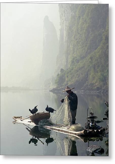 Comorant Birds Sitting On Fisherman's Boat In Li River Greeting Card by King Wu