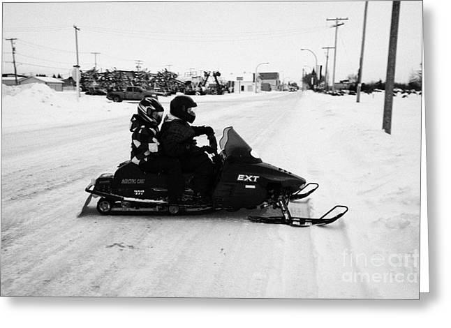 couple on a snowmobile Kamsack Saskatchewan Canada Greeting Card by Joe Fox