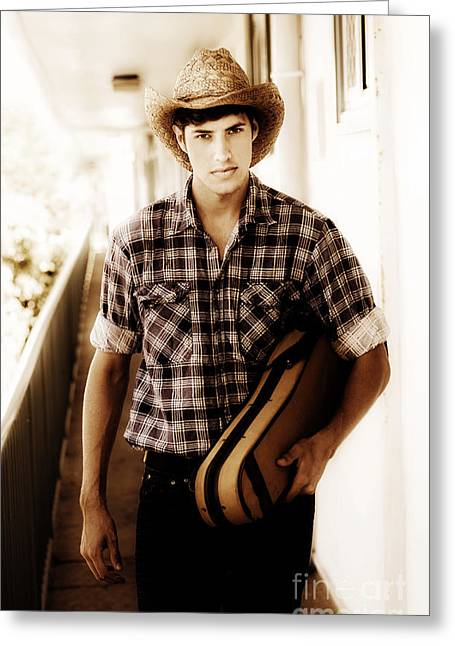 Cowboy Carrying Guitar Greeting Card by Jorgo Photography - Wall Art Gallery
