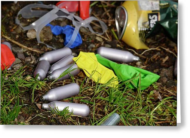 Discarded Laughing Gas Capsules Greeting Card by Cordelia Molloy