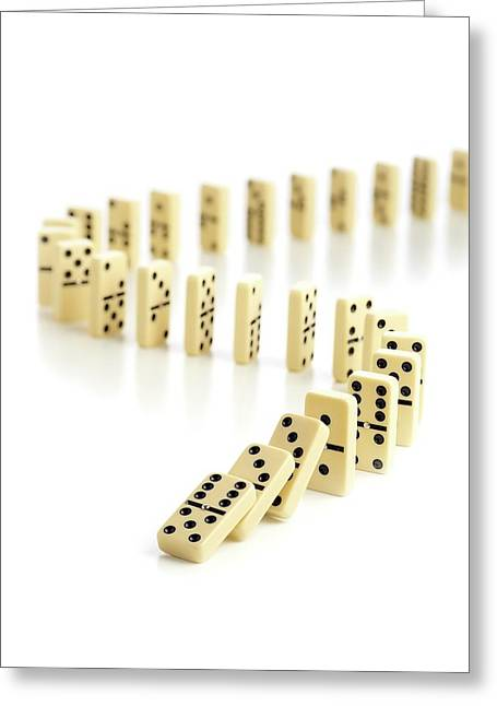 Dominoes Falling Down Greeting Card by Science Photo Library