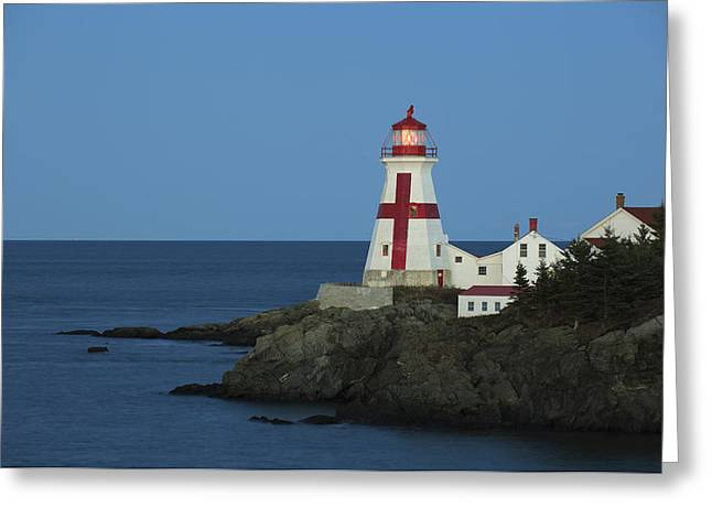 East Quoddy Lighthouse At Dusk Greeting Card by Scott Leslie