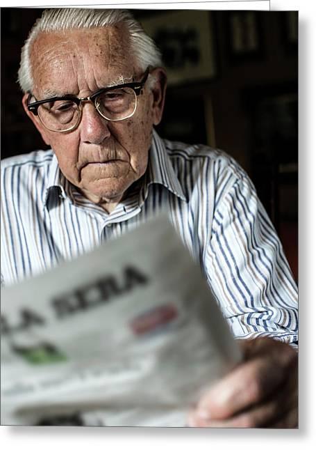 Elderly Man Reading A Newspaper Greeting Card