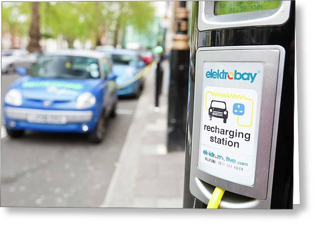 Electric Vehicles At Charging Stations Greeting Card