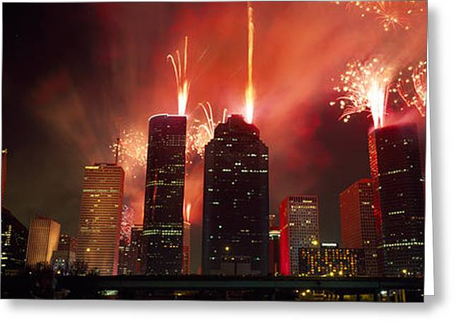 Fireworks Over Buildings In A City Greeting Card by Panoramic Images