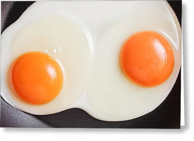 Frying Eggs Greeting Card by Tom Gowanlock