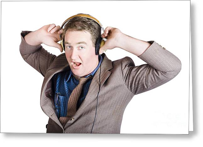 Funny Businessman Wearing Earphones On White Greeting Card by Jorgo Photography - Wall Art Gallery