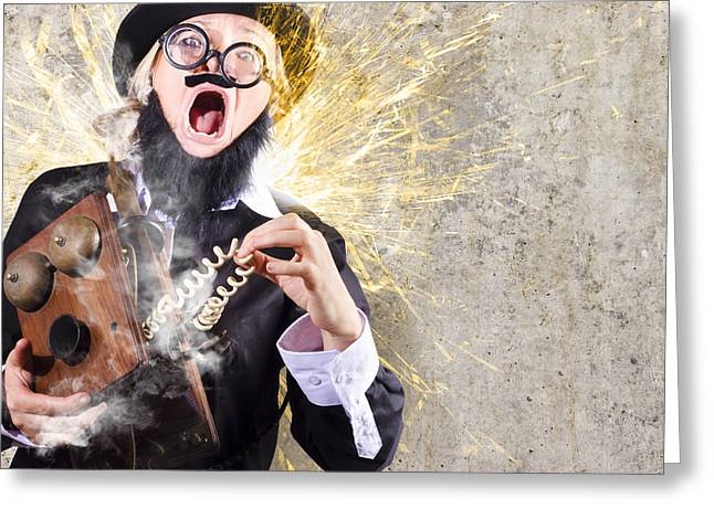 Funny Man Getting Electric Shock From Old Phone Greeting Card by Jorgo Photography - Wall Art Gallery