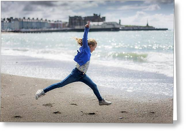 Girl Leaping On Beach Greeting Card