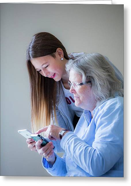 Girl Showing Grandmother Smartphone Greeting Card