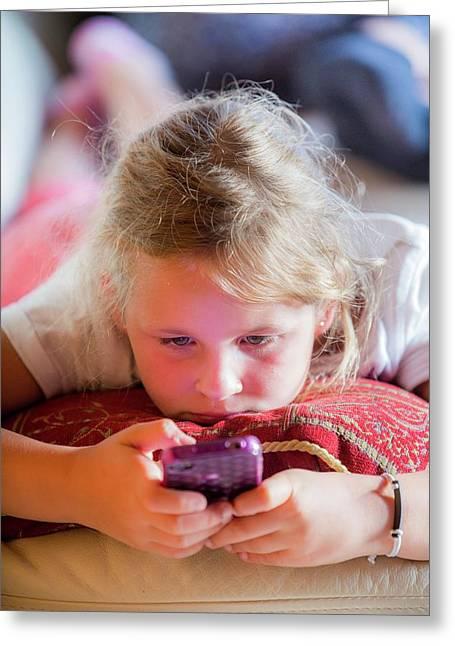 Girl Using A Smartphone Greeting Card by Samuel Ashfield