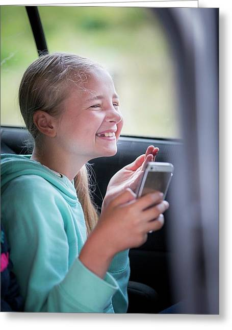 Girl Using Smartphone In Car Greeting Card by Samuel Ashfield