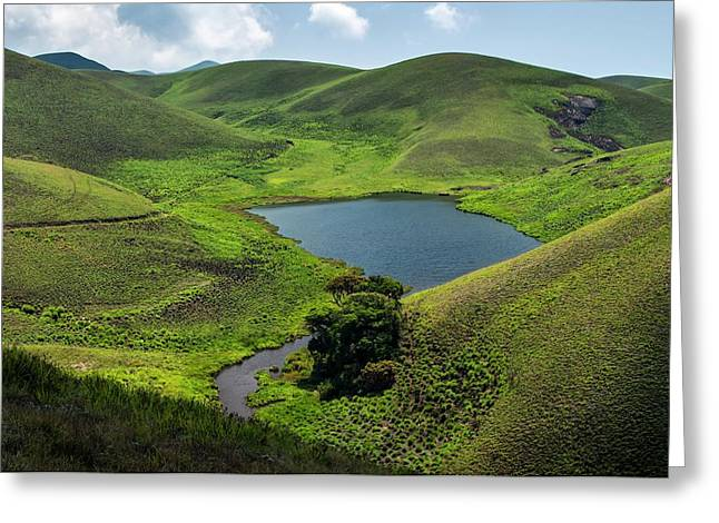 Grassy Hills And Lake Greeting Card by K Jayaram