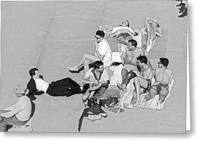 Group Of Men Sunbathing Greeting Card