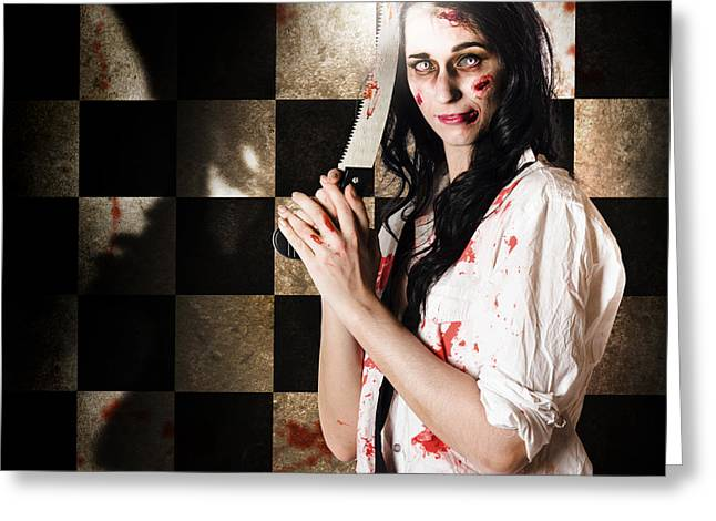 Gruesome Evil Zombie Holding Bloody Saw  Greeting Card by Jorgo Photography - Wall Art Gallery