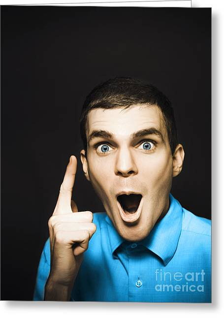 Happy Young Man Pointing At Blank Copyspace Greeting Card