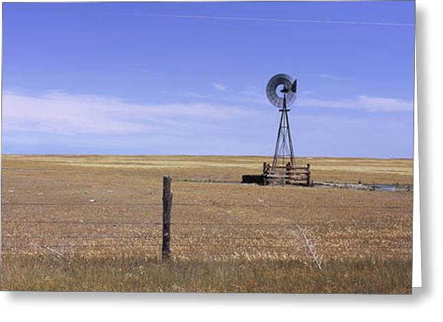 Industrial Windmill On A Landscape Greeting Card