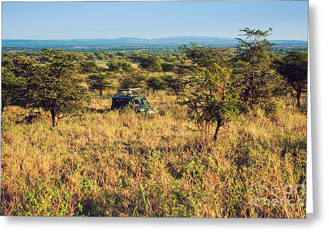 Jeep With Tourists On Safari In Serengeti. Tanzania. Africa. Greeting Card by Michal Bednarek