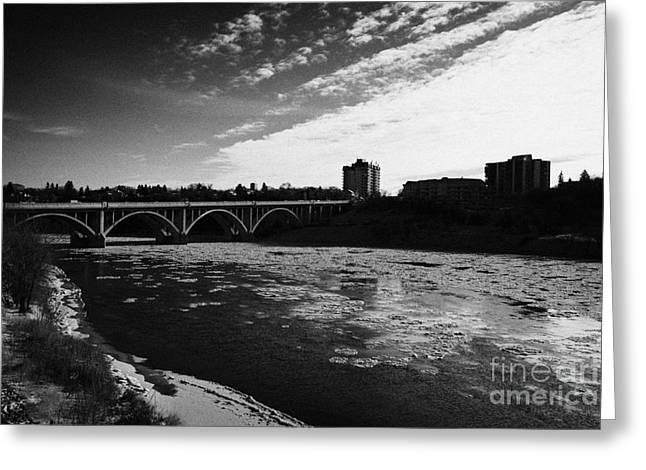 large chunks of floating ice on the south saskatchewan river in winter flowing through downtown Sask Greeting Card