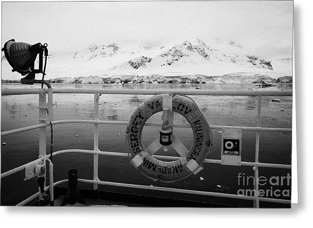 lifebelt on expedition ship covered in snow moored in Fournier Bay on Anvers Island Antarctica Greeting Card