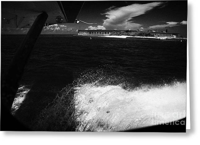 Looking Out Of Seaplane Window Landing On The Water Next To Fort Jefferson Garden Key Dry Tortugas F Greeting Card by Joe Fox