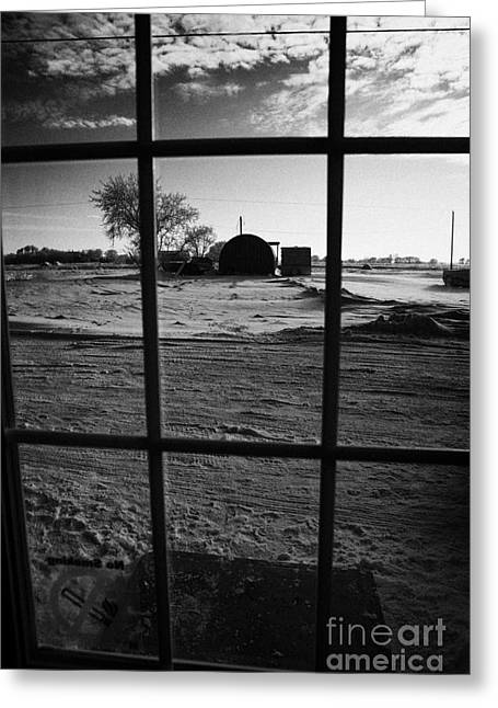 looking out through door window to snow covered scene in small rural village of Forget Saskatchewan  Greeting Card