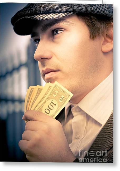 Man Holding Money Making A Financial Decision Greeting Card