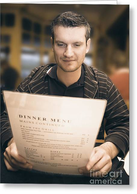 Man In Mid 20s Reading Restaurant Dinner Menu Greeting Card by Jorgo Photography - Wall Art Gallery