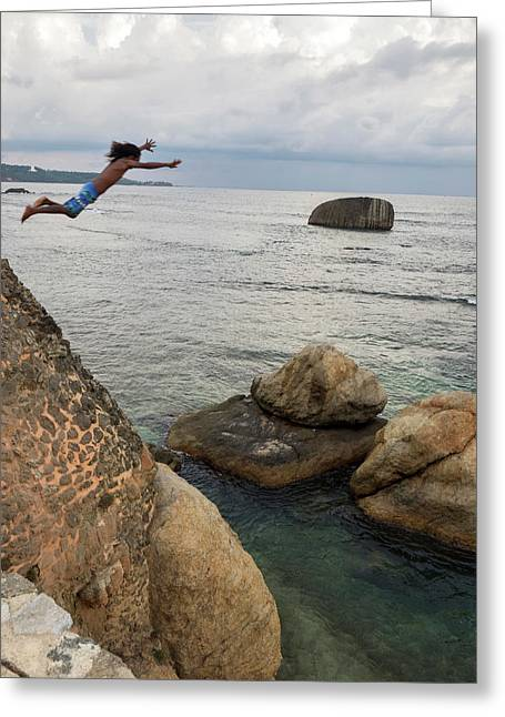 Man Jumping Off Flag Rock Bastion Greeting Card