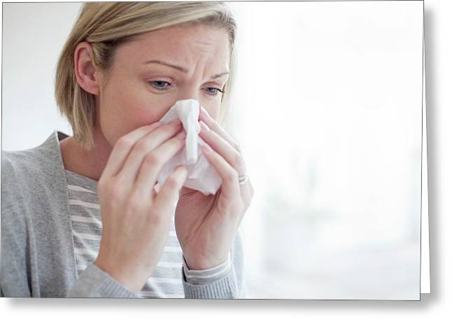 Mid Adult Woman Blowing Her Nose Greeting Card by Science Photo Library