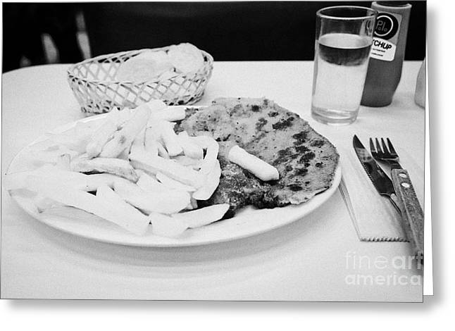milanesa steak with french fries in a cafe Santiago Chile Greeting Card by Joe Fox