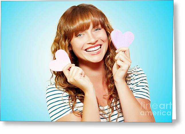 Mischievous Valentine Girl Holding Two Love Hearts Greeting Card