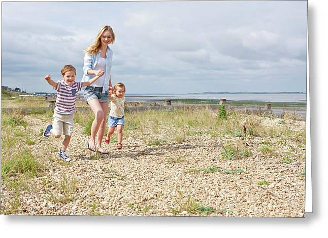 Mother And Children On Beach Greeting Card
