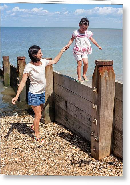 Mother And Daughter On Beach Greeting Card by Ian Hooton