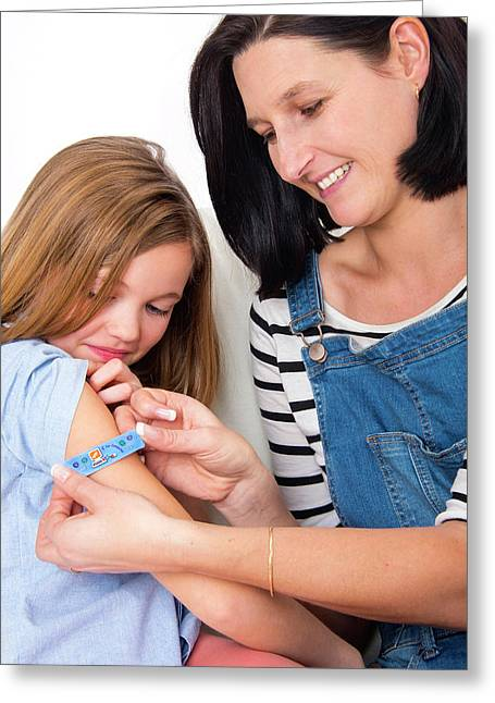 Mother Applying Plaster To Daughter Greeting Card