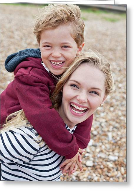 Mother Giving Son Piggy Back Greeting Card by Ian Hooton