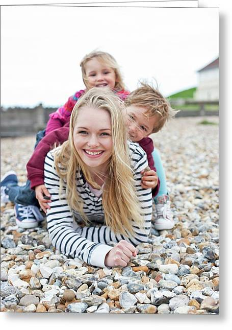 Mother With Children On Beach Greeting Card