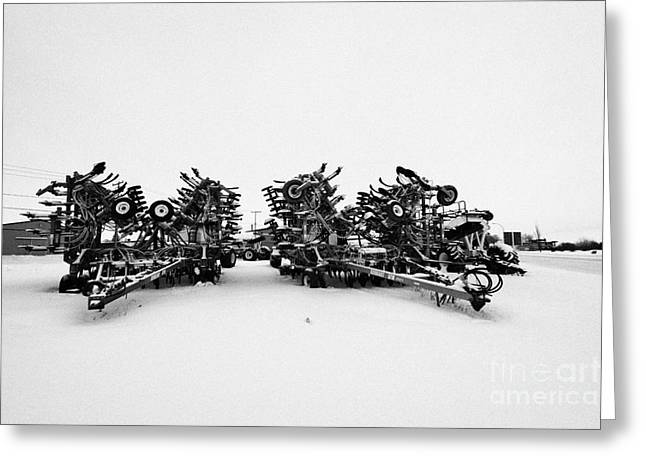 new bourgault 5710 air hoe drill covered in snow in winter Kamsack Saskatchewan Canada Greeting Card by Joe Fox