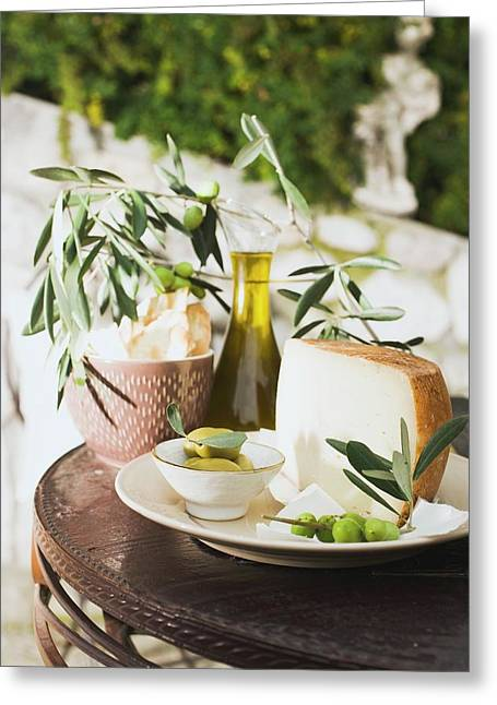 Olives, Cheese, Crackers And Olive Oil On Table Out Of Doors Greeting Card