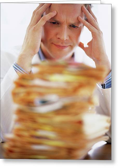 Overworked Doctor Greeting Card by Ian Hooton/science Photo Library