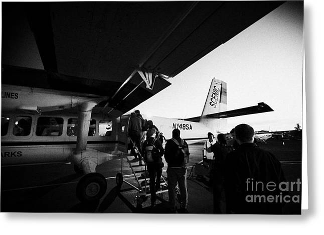 Passengers Boarding Early Morning Dehaviland Twin Otter Light Aircraft Flight To Grand Canyon At Bou Greeting Card by Joe Fox