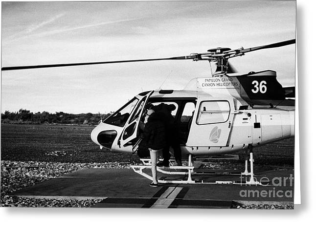 passengers boarding papillon helicopter tours on helipad at Grand canyon west airport Arizona USA Greeting Card by Joe Fox