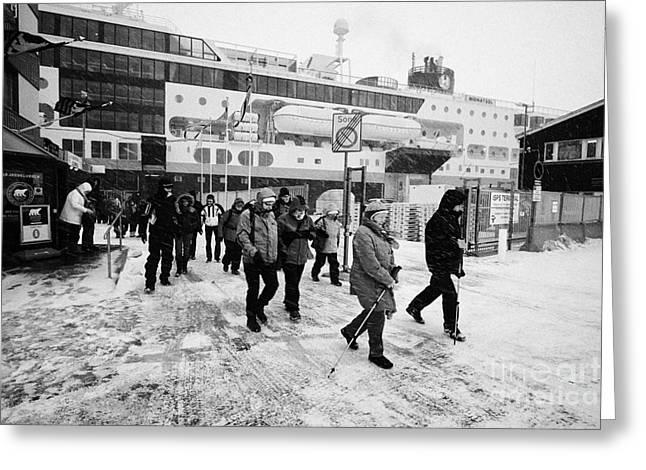 Passengers In A Snow Blizzard Leaving The Hurtigruten Passenger Terminal Hammerfest Finnmark Norway  Greeting Card by Joe Fox