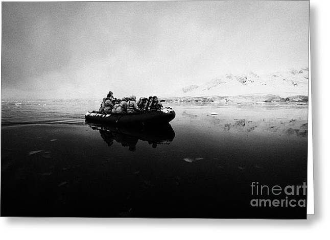Passengers On Board A Zodiac In Fournier Bay On Excursion In Antarctica Greeting Card by Joe Fox