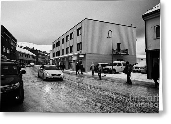 people walking along ice covered storgata main shopping street Honningsvag finnmark norway europe Greeting Card by Joe Fox