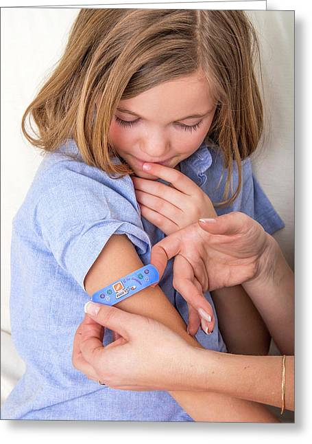 Person Applying Plaster To Girl's Arm Greeting Card