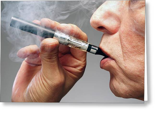 Person Smoking E Cigarette Greeting Card by Victor De Schwanberg