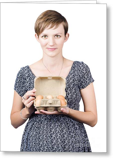 Pregnant Young Woman Displaying A Box Of Eggs Greeting Card